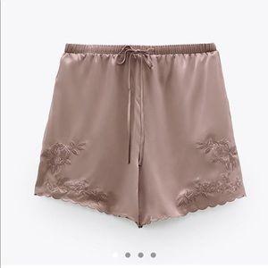 Embroidered silky pyjama shorts.